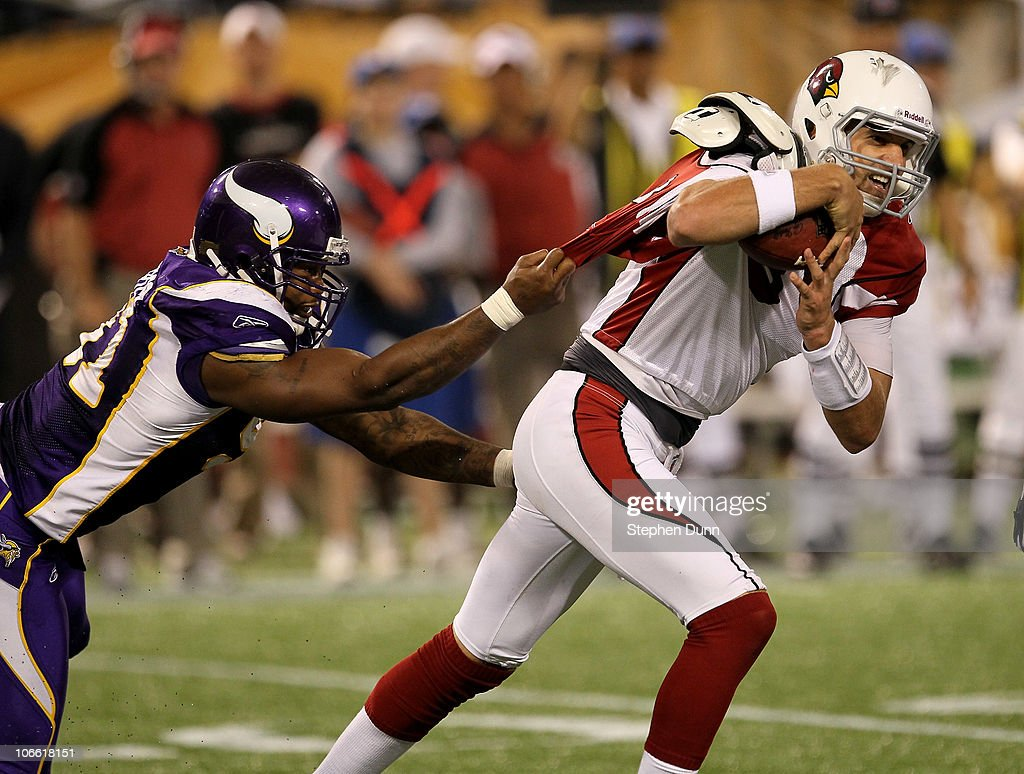 Defensive end Ray Edwards #91 of the Minnesota Vikings grabs the jersey of quarterback Derek Anderson #3 of the Arizona Cardinals at Hubert H. Humphrey Metrodome on November 7, 2010 in Minneapolis, Minnesota. The Vikings won 27-24 in overtime.