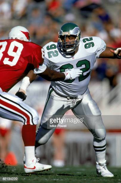 Defensive end Reggie White of the Philadelphia Eagles avoids offense as he runs pass coverage during a game against the Phoenix Cardinals on November...