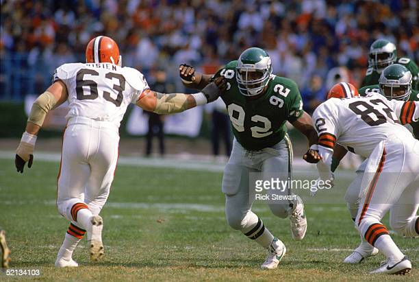 Defensive end Reggie White of the Philadelphia Eagles dodges offense as he runs pass coverage against the Browns at Cleveland Municipal Stadium on...
