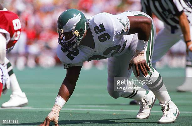 Defensive end Reggie White of the Philadelphia Eagles gets set for the next play during a 1991 season game at Veterans Stadium against the Phoenix...