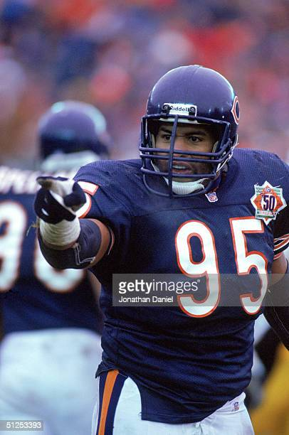 Defensive end Richard Dent of the Chicago Bears points during a game against the Pittsburgh Steelers at Soldier Field on December 13 1992 in Chicago...