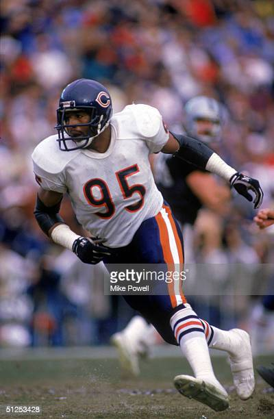 Defensive end Richard Dent of the Chicago Bears runs on the field during a game against the Los Angeles Raiders at Los Angeles Memorial Coliseum on...