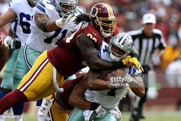 Defensive end Ricky Jean Francois of the Washington Redskins tackles quarterback Dak Prescott of the Dallas Cowboys in the first quarter at...