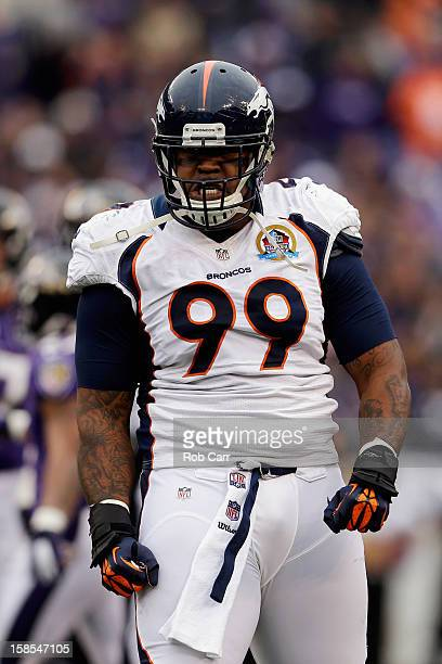 Defensive end Robert Ayers of the Denver Broncos reacts to a first half play against the Baltimore Ravens at M&T Bank Stadium on December 16, 2012 in...