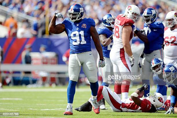 Defensive end Robert Ayers of the New York Giants celebrates a defensive stop against the Arizona Cardinals during a game at MetLife Stadium on...