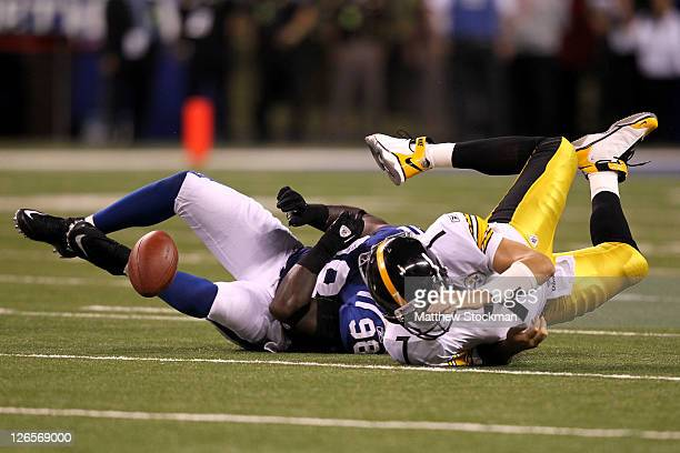 Defensive end Robert Mathis of the Indianapolis Colts sacks quarterback Ben Roethlisberger of the Pittsburgh Steelers and forces a fumble and...
