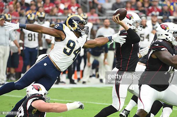 Defensive end Robert Quinn of the Los Angeles Rams lounges after quarterback Carson Palmer of the Arizona Cardinals in the first half of the NFL game...