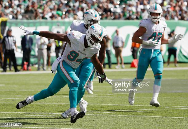 Defensive end Robert Quinn of the Miami Dolphins celebrates against the New York Jets during the first half at MetLife Stadium on September 16 2018...