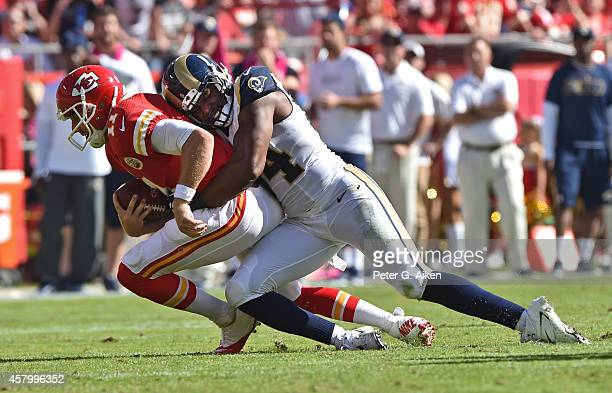 Defensive end Robert Quinn of the St Louis Rams sacks quarterback Alex Smith of the Kansas City Chiefs during the first half on October 26 2014 at...