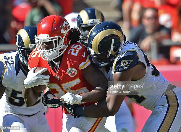 Defensive end Robert Quinn of the St Louis Rams tackles running back Jamaal Charles of the Kansas City Chiefs during the second half on October 26...