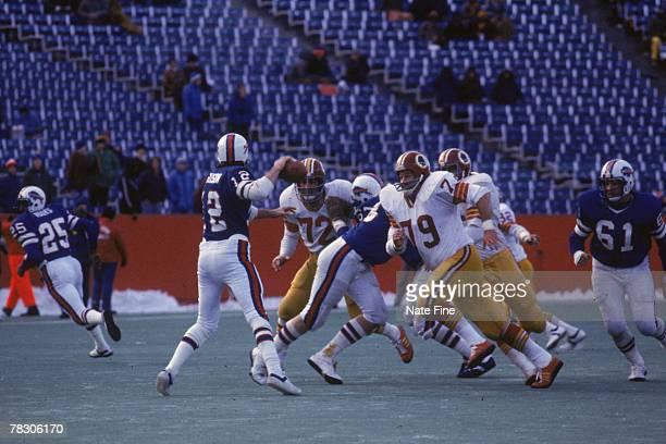 Defensive end Ron McDole of the Washington Redskins pressurs quarterback Joe Ferguson of the Buffalo Bills at Rich Stadium on December 4 1977 in...