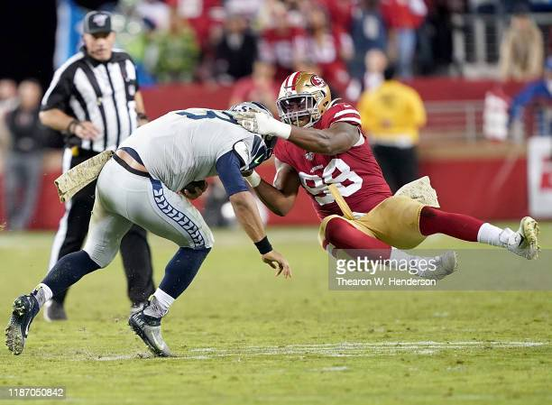 Defensive end Ronald Blair of the San Francisco 49ers tackles quarterback Russell Wilson of the Seattle Seahawks in the game at Levi's Stadium on...