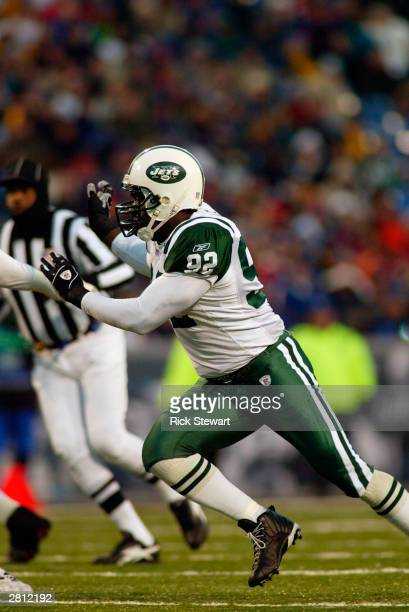 Defensive end Shaun Ellis of the New York Jets runs on the field during the game against the Buffalo Bills on December 7 2003 at Ralph Wilson Stadium...