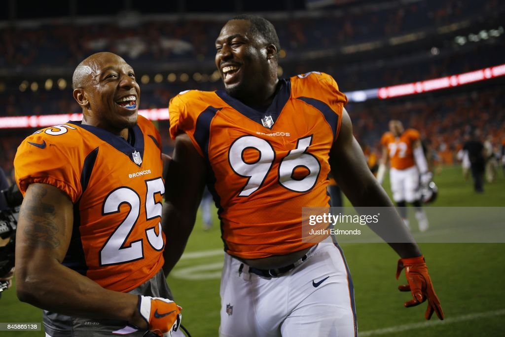 Defensive end Shelby Harris #96 of the Denver Broncos celebrates winning the game with Chris Harris #25 against the Los Angeles Chargers at Sports Authority Field at Mile High on September 11, 2017 in Denver, Colorado. Harris blocked the game-tying field goal in the fourth quarter.