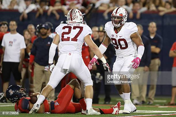 Defensive end Solomon Thomas of the Stanford Cardinal celebrates with linebacker Sean Barton after a sack on quarterback Brandon Dawkins of the...