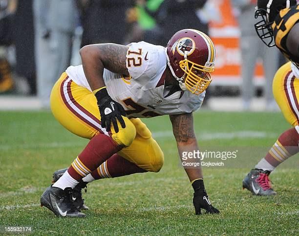 Defensive end Stephen Bowen of the Washington Redskins looks on from the line of scrimmage during a game against the Pittsburgh Steelers at Heinz...