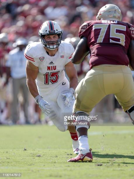 Defensive End Sutton Smith of the Northern Illinois Huskies is defended by Tackle Adbul Bello of the Florida State Seminoles during the game at Doak...