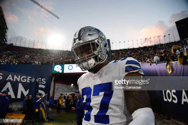 Defensive end Taco Charlton of the Dallas Cowboys walks onto the field ahead of the NFC Divisional Round playoff game against the Los Angeles Rams at...