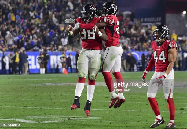 Defensive end Takkarist McKinley and free safety Damontae Kazee of the Atlanta Falcons celebrate a stop on a fourth down during the fourth quarter of...