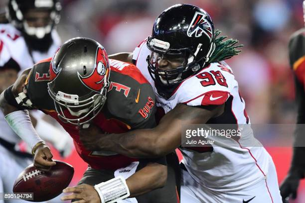 Defensive end Takkarist McKinley of the Atlanta Falcons wraps up quarterback Jameis Winston of the Tampa Bay Buccaneers to cause a fumble in the...