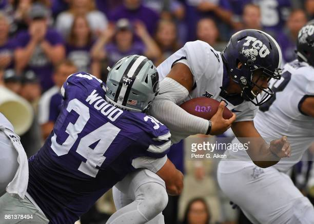 Defensive end Tanner Wood of the Kansas State Wildcats sacks quarterback Kenny Hill of the TCU Horned Frogs during the first half on October 14 2017...
