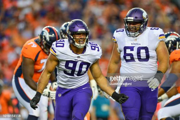 Defensive end Tashawn Bower of the Minnesota Vikings celebrates after a sack of quarterback Paxton Lynch of the Denver Broncos during an NFL...