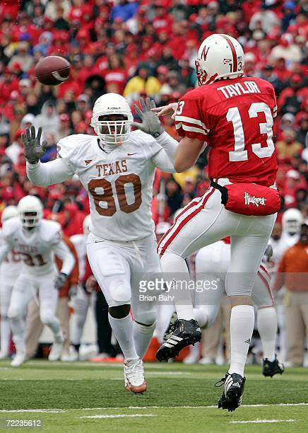 Defensive end Tim Crowder of the Texas Longhorns pressures quarterback Zac Taylor of the Nebraska Cornhuskers in the fourth quarter on on October 21...