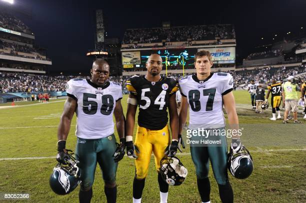 Defensive end Trent Cole and tight end Brent Celek of the Philadelphia Eagles pose for a photo with linebacker Andre Frazier of the Pittsburgh...