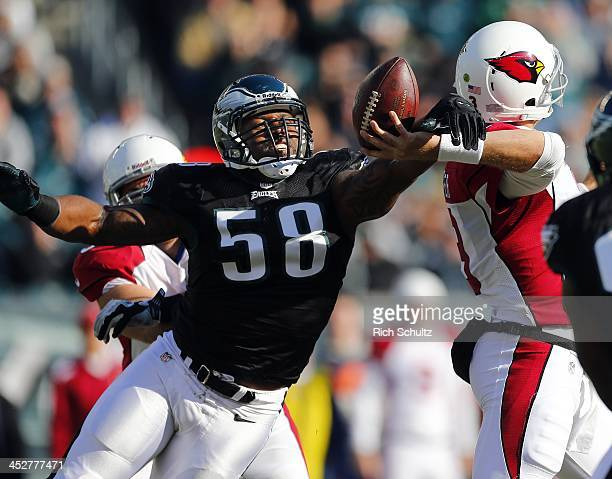 Defensive end Trent Cole of the Philadelphia Eagles hits the arm of quarterback Carson Palmer of the Arizona Cardinals causing a fumble that was...