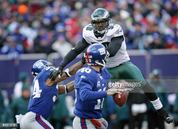 Defensive end Trent Cole of the Philadelphia Eagles rushes quarterback Eli Manning of the New York Giants during the NFC Divisional Playoff game on...