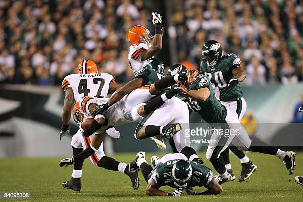 Defensive end Trent Cole of the Philadelphia Eagles tackles wide receiver Joshua Cribbs of the Cleveland Browns during a game on December 15, 2008 at...