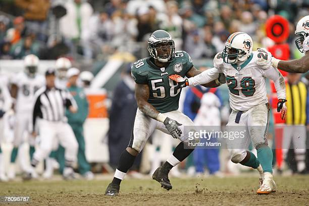 Defensive end Trent Cole of the Philadelphia Eagles tries to get around running back Jesse Chatman of the Miami Dolphins during a game on November...