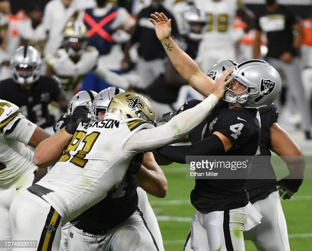 Defensive end Trey Hendrickson of the New Orleans Saints is called for roughing the passer as he hits quarterback Derek Carr of the Las Vegas Raiders...