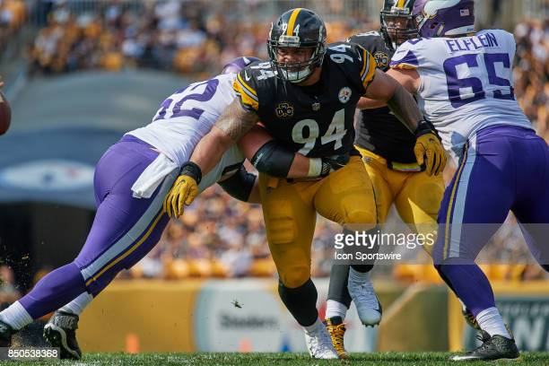 Defensive end Tyson Alualu of the Pittsburgh Steelers battle with offensive guard Nick Easton of the Minnesota Vikings and center Pat Elflein of the...
