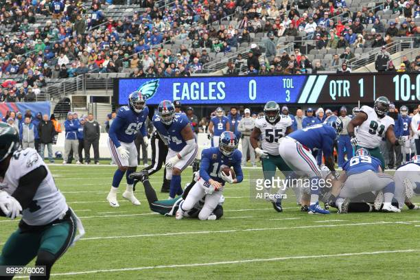 Defensive End Vinny Curry of the Philadelphia Eagles has a sack against the New York Giants during the game at MetLife Stadium on December 17, 2017...
