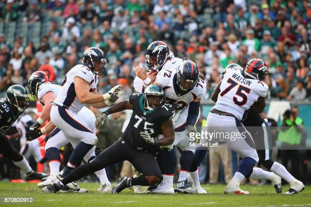 Defensive end Vinny Curry of the Philadelphia Eagles sacks quarterback Brock Osweiler of the Denver Broncos during the second quarter at Lincoln...
