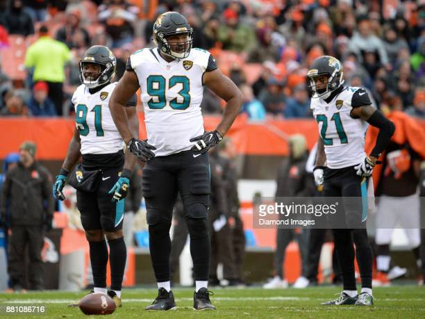 Defensive end Yannick Ngakoue defensive lineman Calais Campbell and cornerback AJ Bouye of the Jacksonville Jaguars stand on the field in the first...