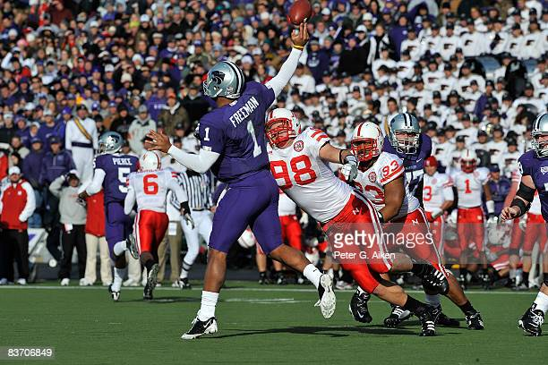 Defensive end Zach Potter of the Nebraska Cornhuskers hits quarterback Josh Freeman of the Kansas State Wildcats as he releases the ball during the...