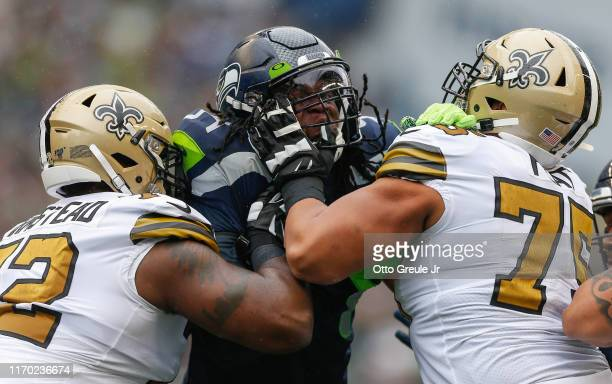 Defensive end Ziggy Ansah of the Seattle Seahawks battles Terron Armstead and Andrus Peat of the New Orleans Saints at CenturyLink Field on September...