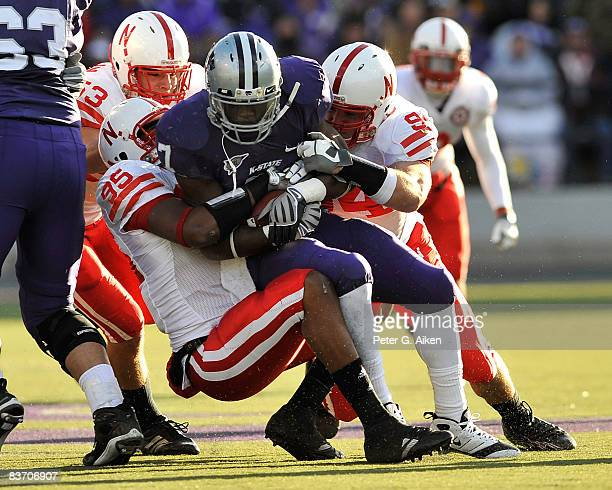 Defensive ends Jared Crick and Pierre Allen of the Nebraska Cornhuskers tackle running back Lamark Brown of the Kansas State Wildcats for a loss...