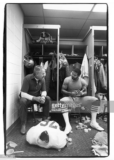 Defensive line coach Bill McPherson and defensive end Dwaine Board of the San Francisco 49ers talk in the locker room before the 1986 NFC Divisional...