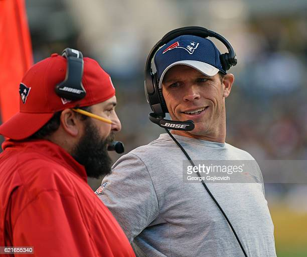 Defensive line coach Brendan Daly of the New England Patriots talks to defensive coordinator Matt Patricia on the sideline during a game against the...