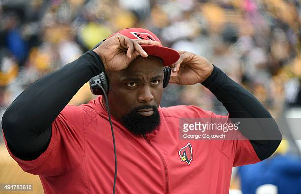 Defensive line coach Brentson Buckner of the Arizona Cardinals looks on from the sideline during a game against the Pittsburgh Steelers at Heinz...