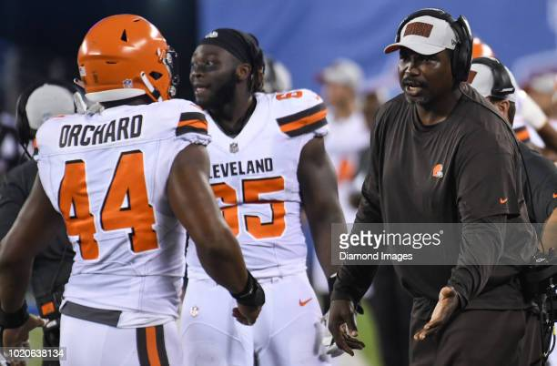 Defensive line coach Clyde Simmons of the Cleveland Browns greets defensive end Nate Orchard on the sideline in the fourth quarter of a preseason...