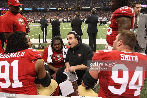Defensive Line Coach Jim Tomsula of the San Francisco 49ers talks with Ray McDonald Justin Smith Ricky Jean Francois during Super Bowl XLVII against...