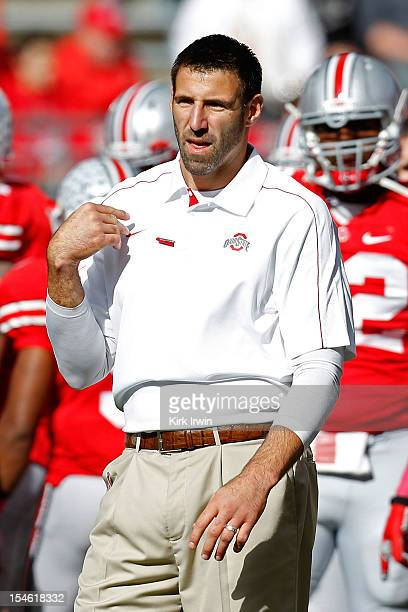 Defensive Line Coach Mike Vrabel of the Ohio State Buckeyes coaches his players during warmups prior to the start of the game against the Purdue...