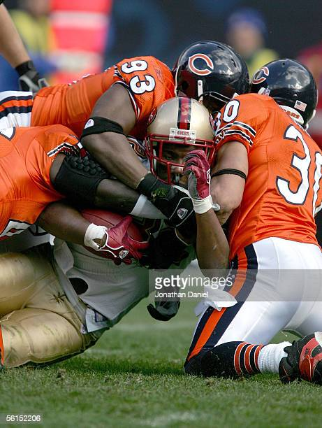 Defensive lineman Adewale Ogunleye and safety Mike Brown of the Chicago Bears stop Kevan Barlow of the San Francisco 49ers on November 13 2005 at...
