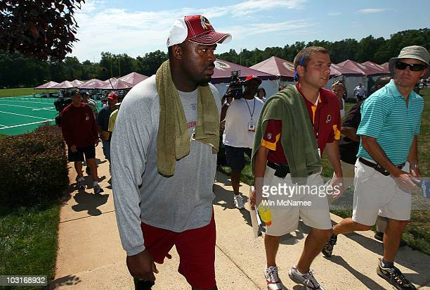 Defensive lineman Albert Haynesworth returns to the locker room following a workout session with Redskins defensive coordinator Jim Haslett on the...