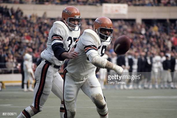 Defensive lineman Bill Kollar of the Cincinnati Bengals swats at the football as defensive back Tommy Casanova watches the play during a game on...