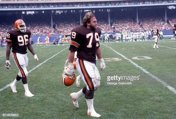 Defensive lineman Bob Golic of the Cleveland Browns walks on the field with teammate Reggie Camp during a game against the New York Jets at Municipal...